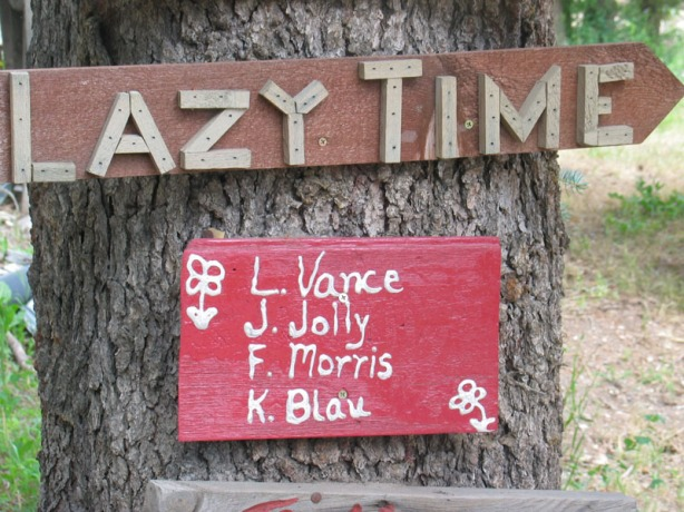 Sign on a tree for cabins in the area