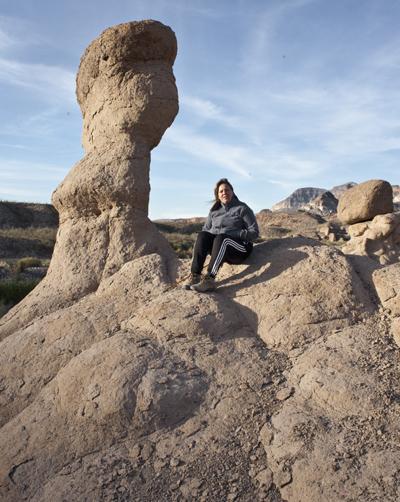sharon on weathered rocks